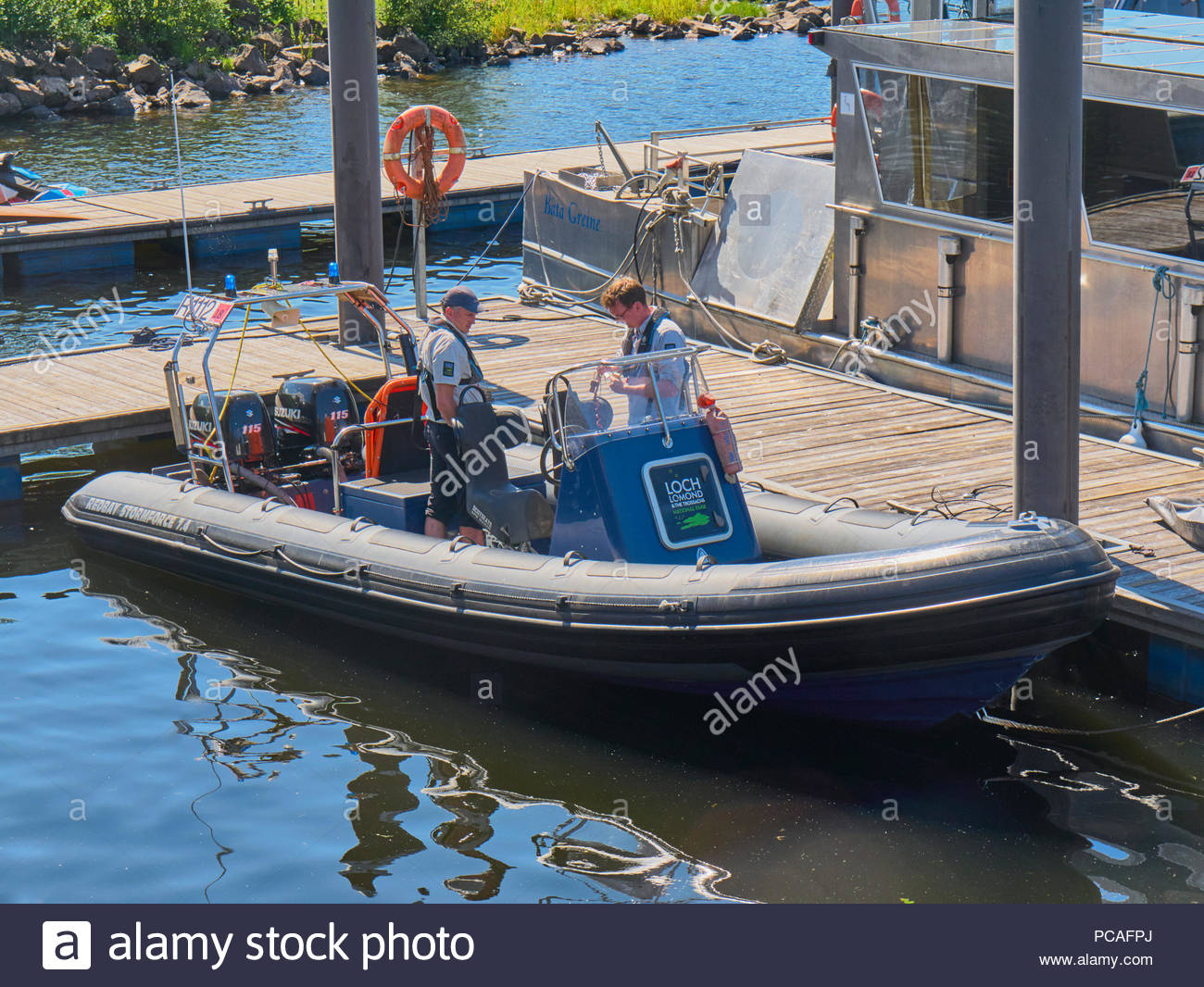 two patrol sailors in a redbay stormforce 7.4 boat with 2 suzuki 115 hp outboard motors on loch lomond trossachs national park scotland uk - Stock Image