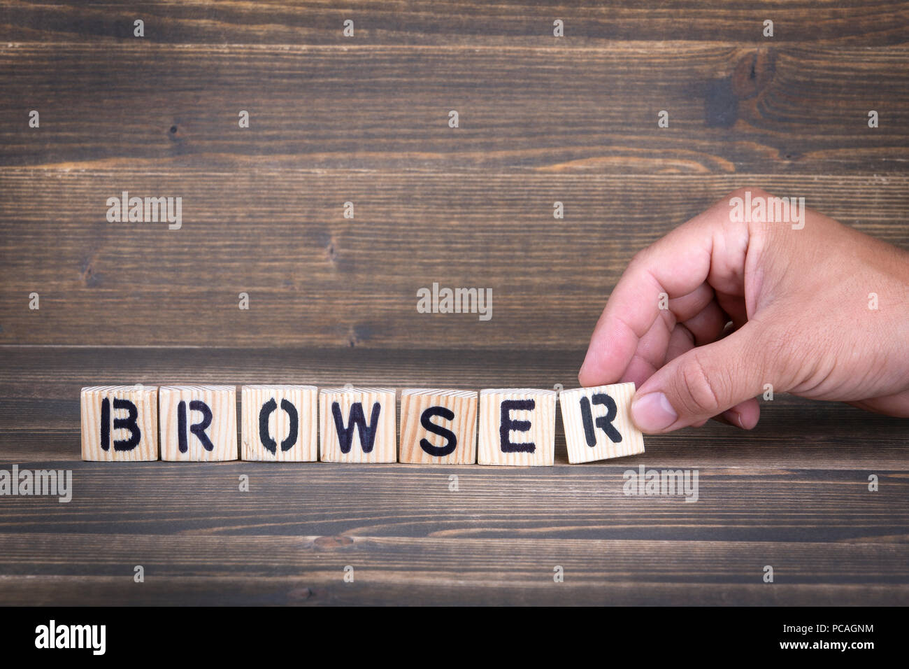 browser. wooden letters on the office desk - Stock Image