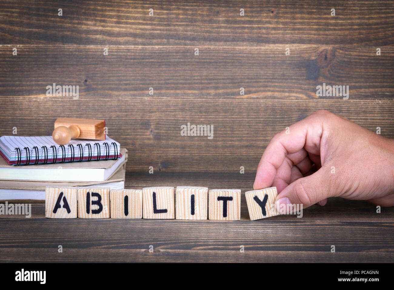 ability. wooden letters on the office desk - Stock Image