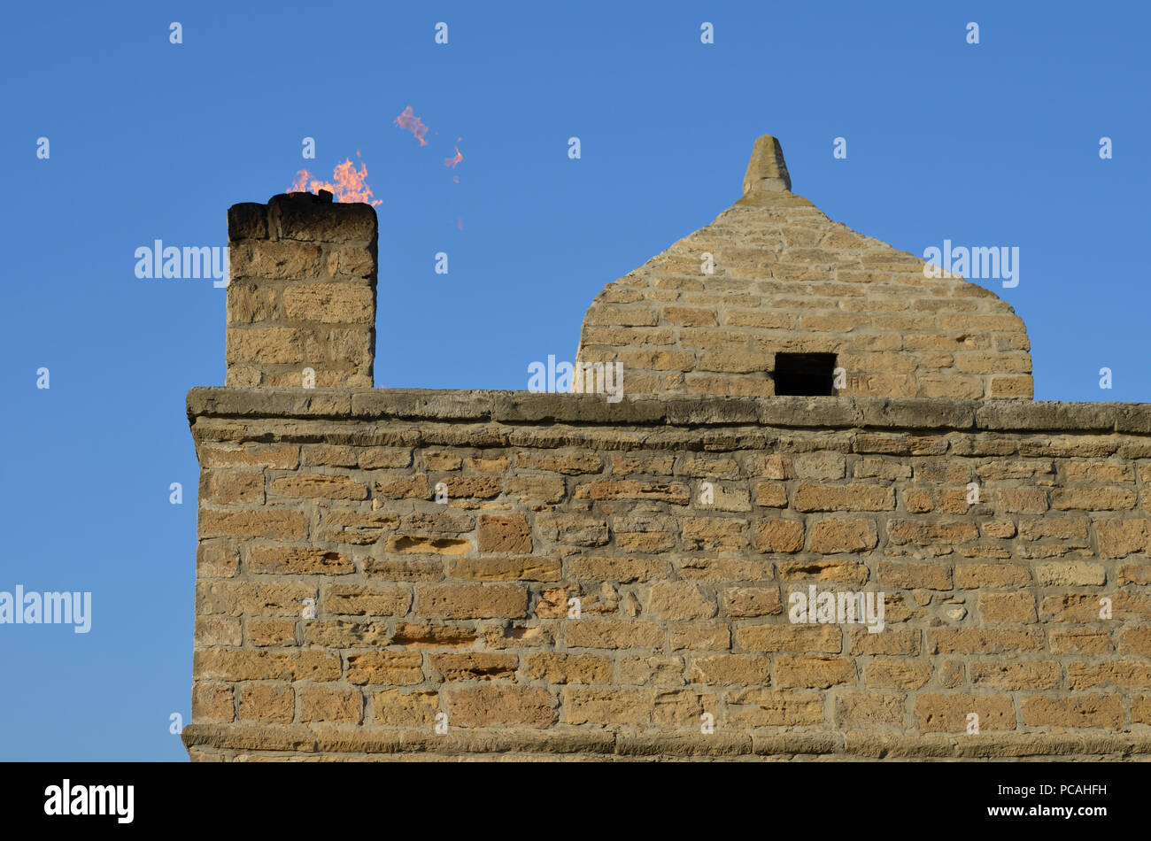 Zoroastrian Fire temple Ateshgah in Surakhani, near Baku, Azerbaijan. An example of religious syncretism inspired by natural eternal fires. - Stock Image