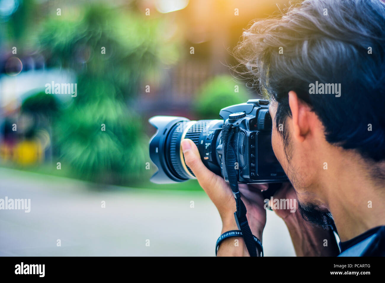 Man Using Camera Dslr Taking Photo Sunlight Background Stock Photo