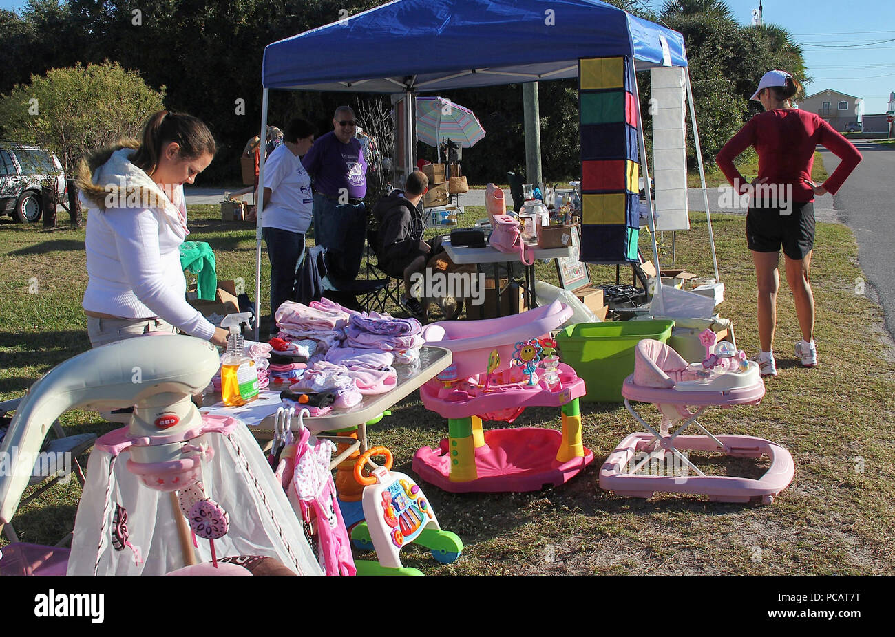 ca. 2010 Shoppers peruse the merchandise on display at a stop along the A1A Super Scenic 72-mile Garage Sale. - Stock Image
