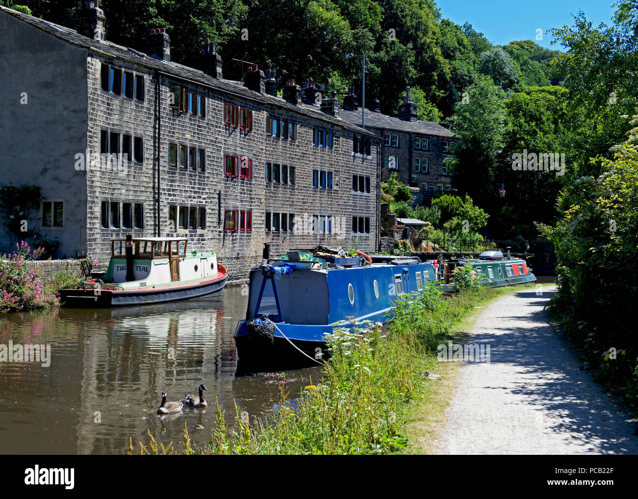 Narrowboats on the Rochdale Canal, Hebden Bridge, West Yorkshire, England UK - Stock Image