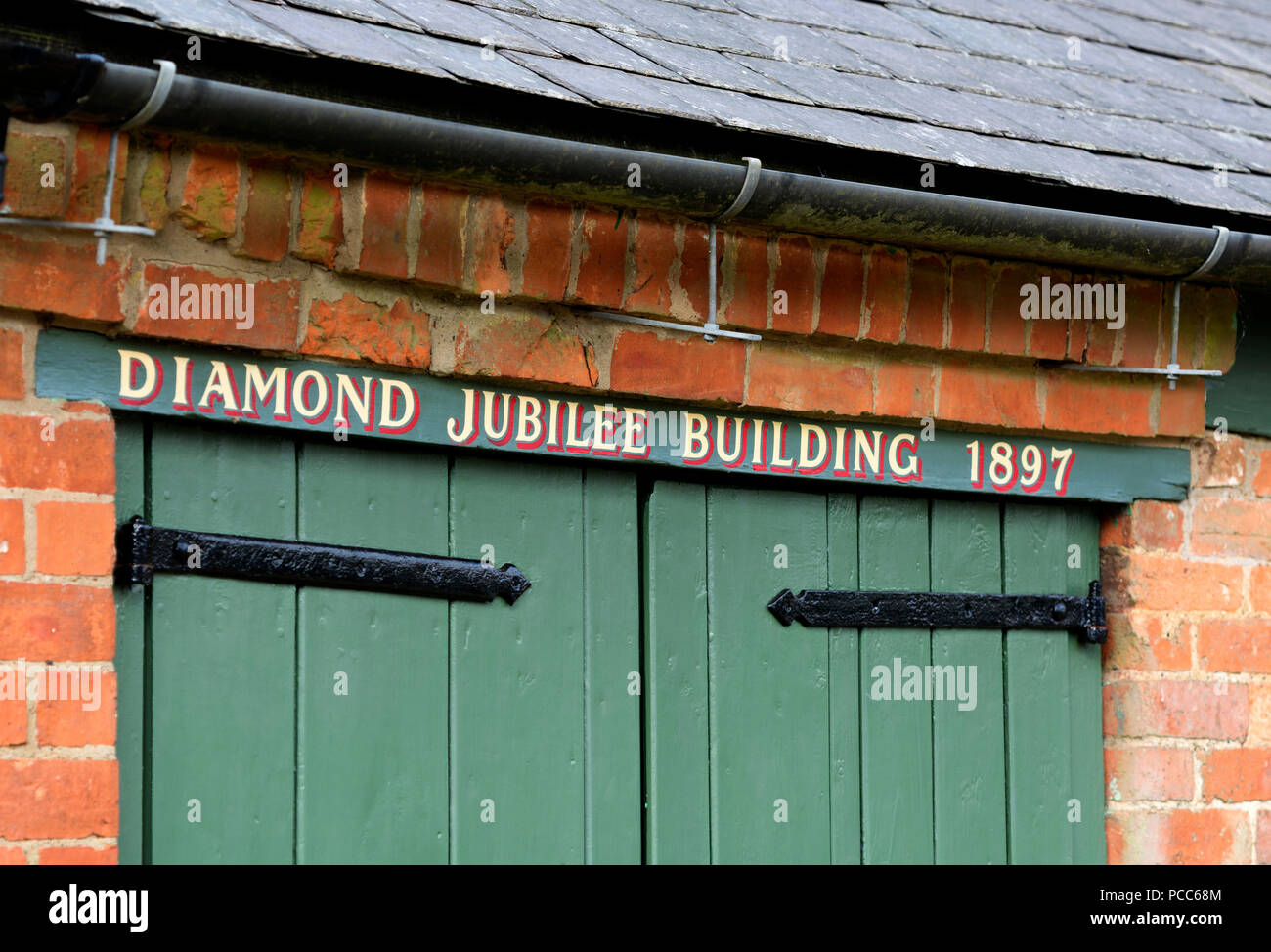 The Diamond Jubilee Building (the Old Coal Barn and Old Fire Engine House), Guilsborough, Northamptonshire, England, UK - Stock Image