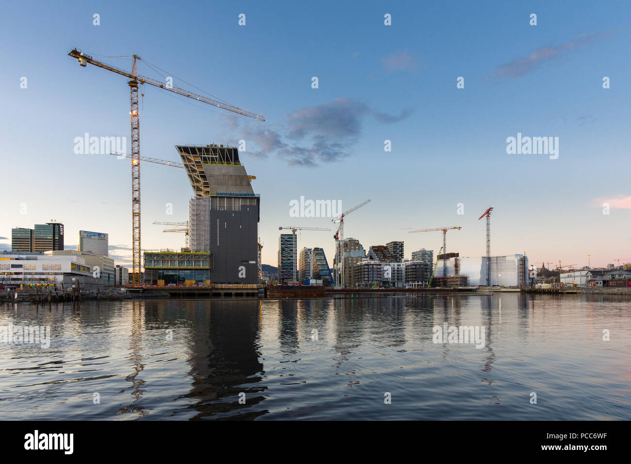 Oslo, Norway -April 27, 2018: Modern buildings known as Barcode Project under construction in the center of Oslo at the sunset - Stock Image