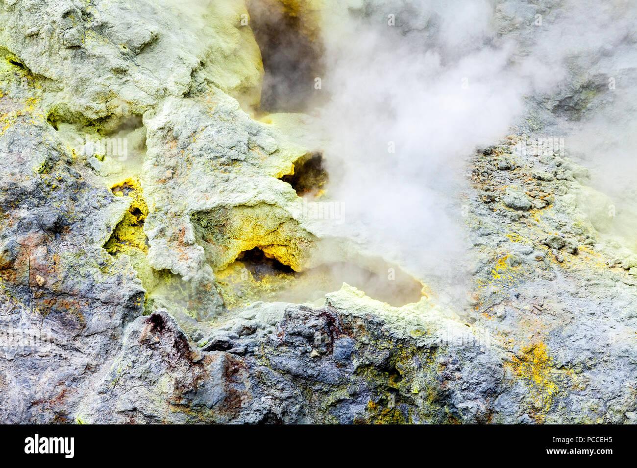 Steam, sulfuric, active fumaroles near the Mutnovsky volcano, Kamchatka peninsula, Russia - Stock Image