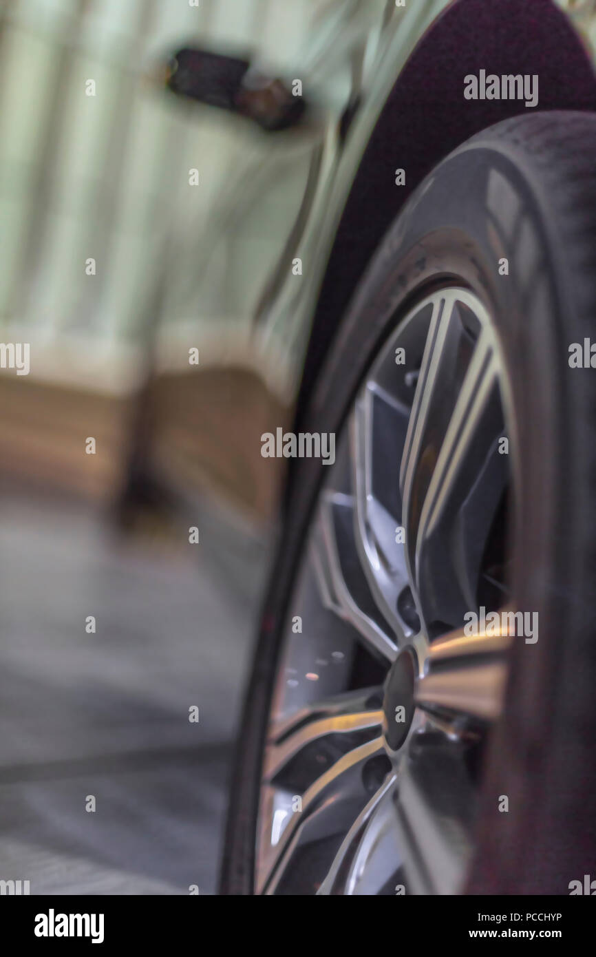 car wheel in detail with blurred background - Stock Image