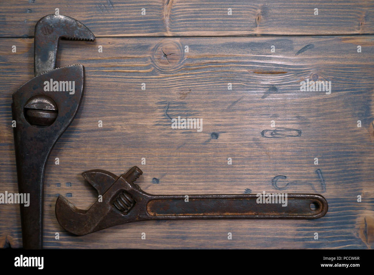 Vintage rusty adjustable and gas wrenches on a weathered wood ...