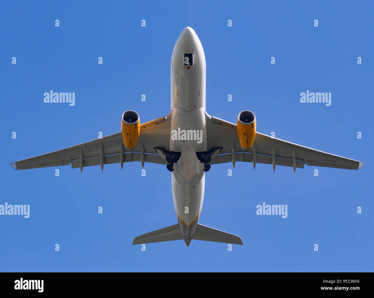 Thomas Cook G-TCXC Airbus A330-243 landing at Manchester Airport - Stock Image