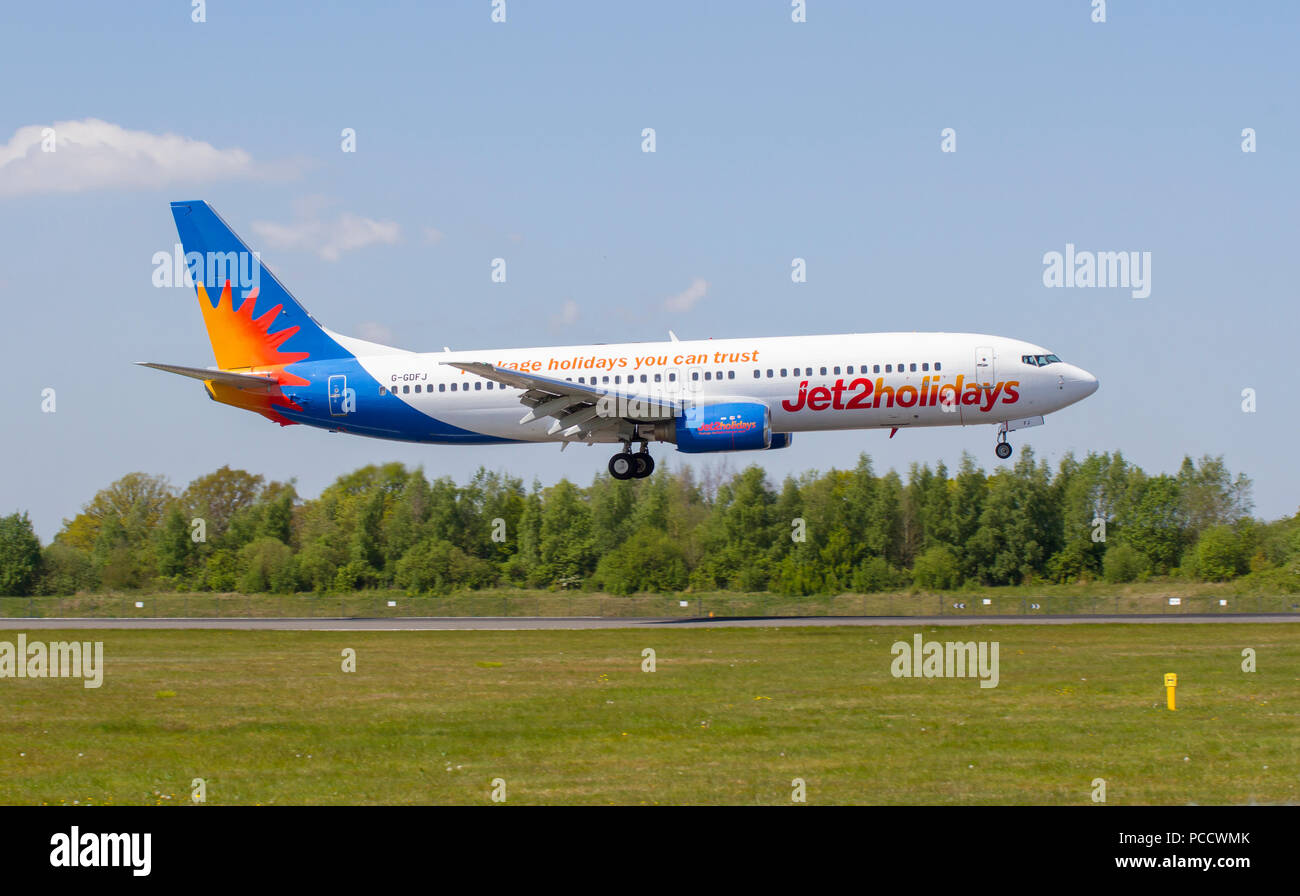 Jet2Holidays flight G-GDFJ Boeing 737-804 Landing at Manchester Airport - Stock Image