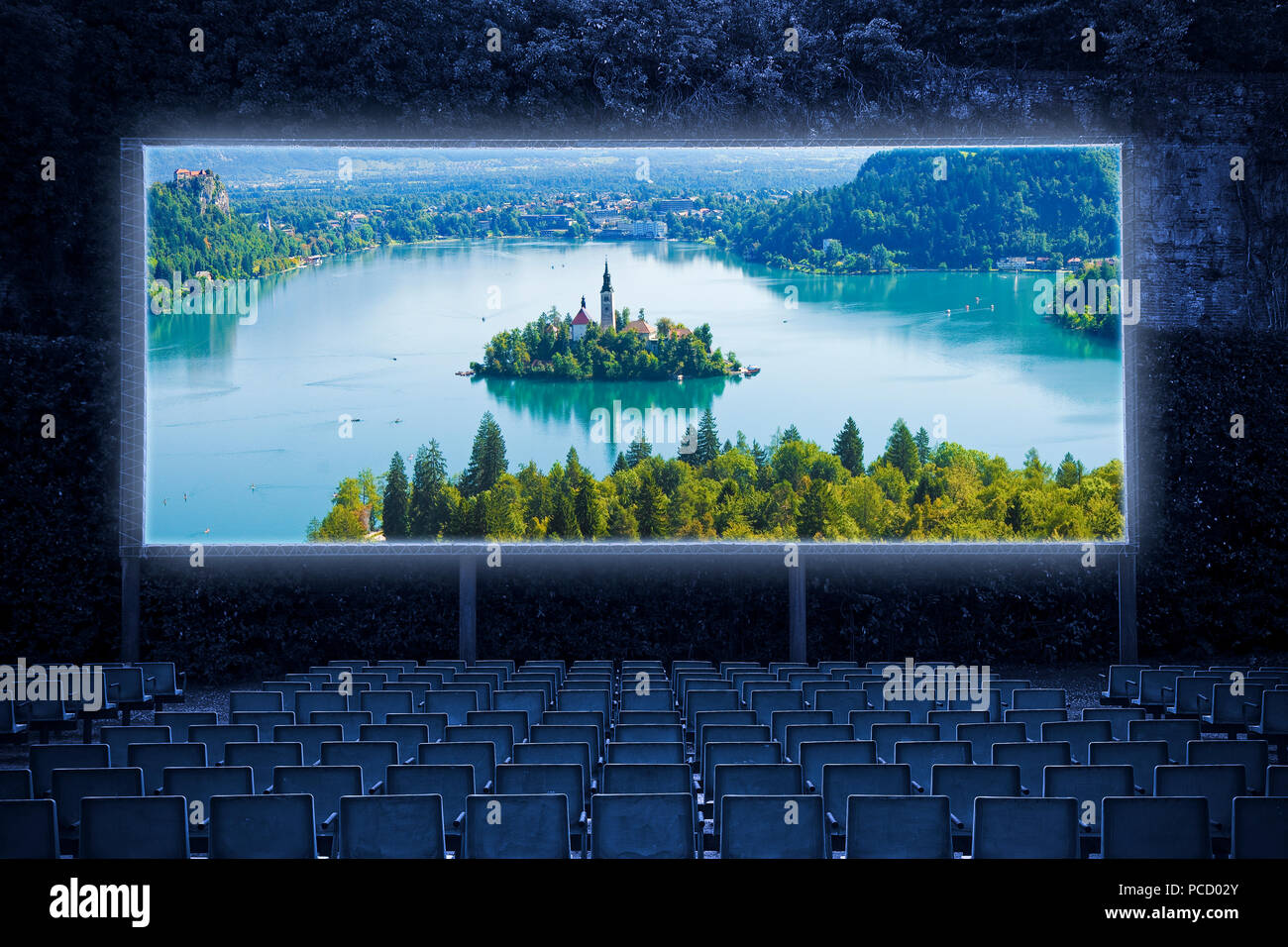 Bled lake, the most famous lake in Slovenia with the island of the church (Europe - Slovenia) - panoramic view - Outdoor cinema concept image - Stock Image