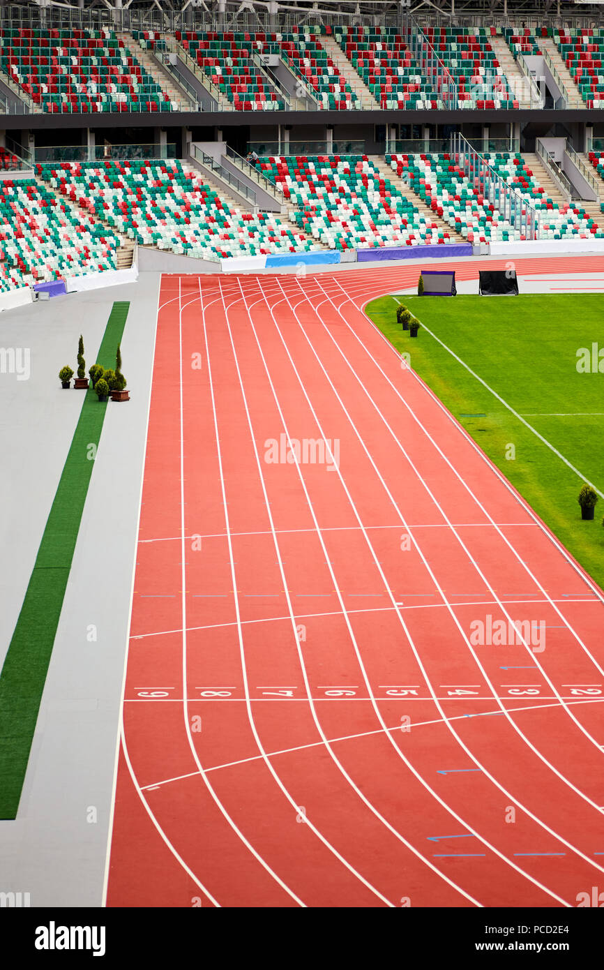 View from above on empty treadmill with several numbered stripes in the stadium - Stock Image