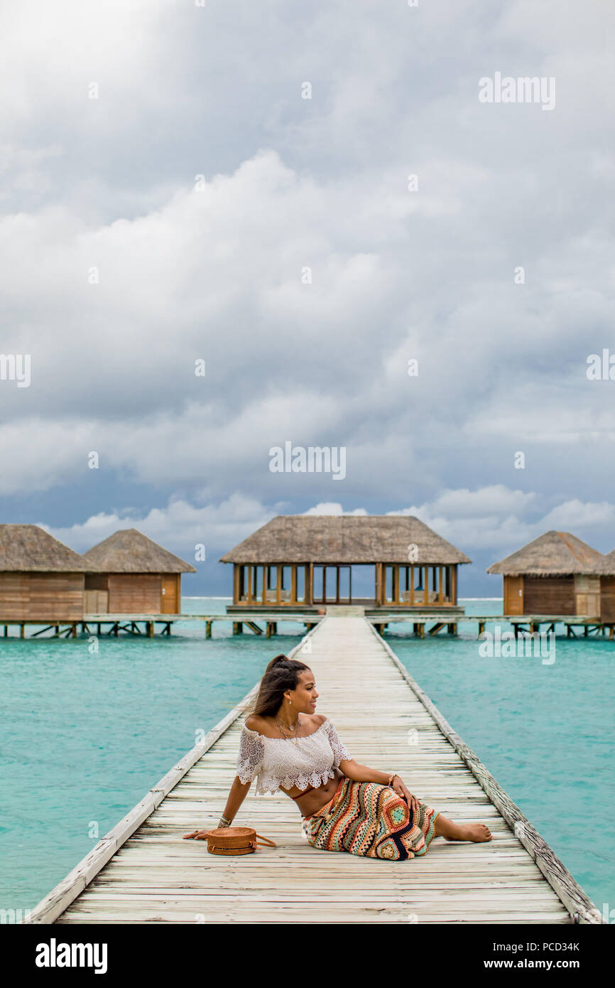 Relaxing at the Conrad Maldives Rangali Island over water yoga studio, Maldives, Indian Ocean, Asia - Stock Image