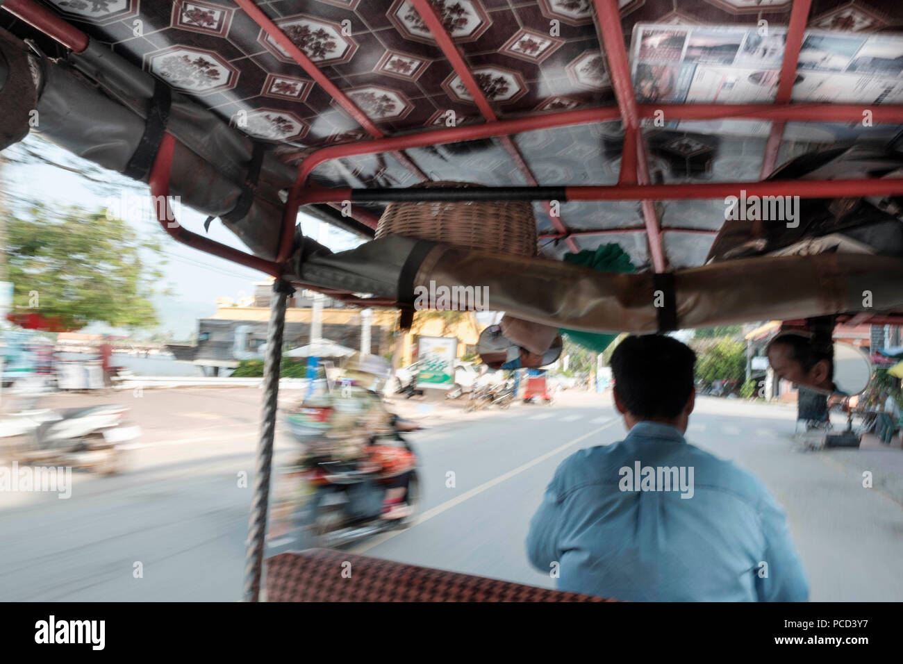 Tuk tuk driver in the streets of Kampt Town, Cambodia, Indochina, Southeast Asia, Asia - Stock Image