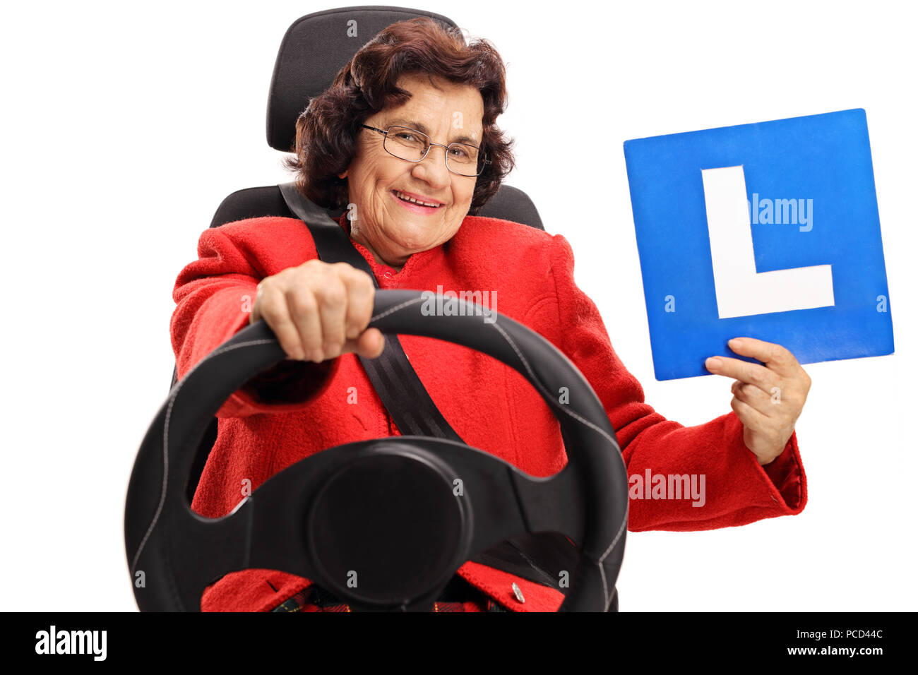 Mature woman driving and showing an l sign isolated on white background