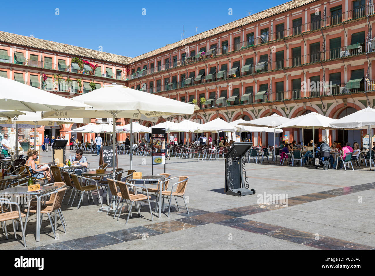 Cafes and restaurants in the Plaza de la Corredera, Cordoba, Andalucia, Spain, Europe - Stock Image