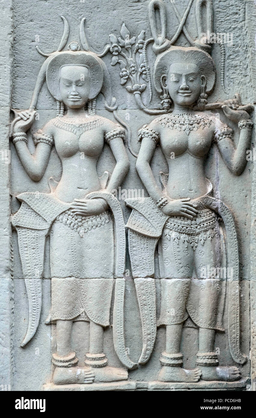 Carvings of Apsaras (spirit of the clouds and waters in Hindu and Buddhist culture) on the exterior of a temple at Angkor, UNESCO, Siem Reap, Cambodia - Stock Image
