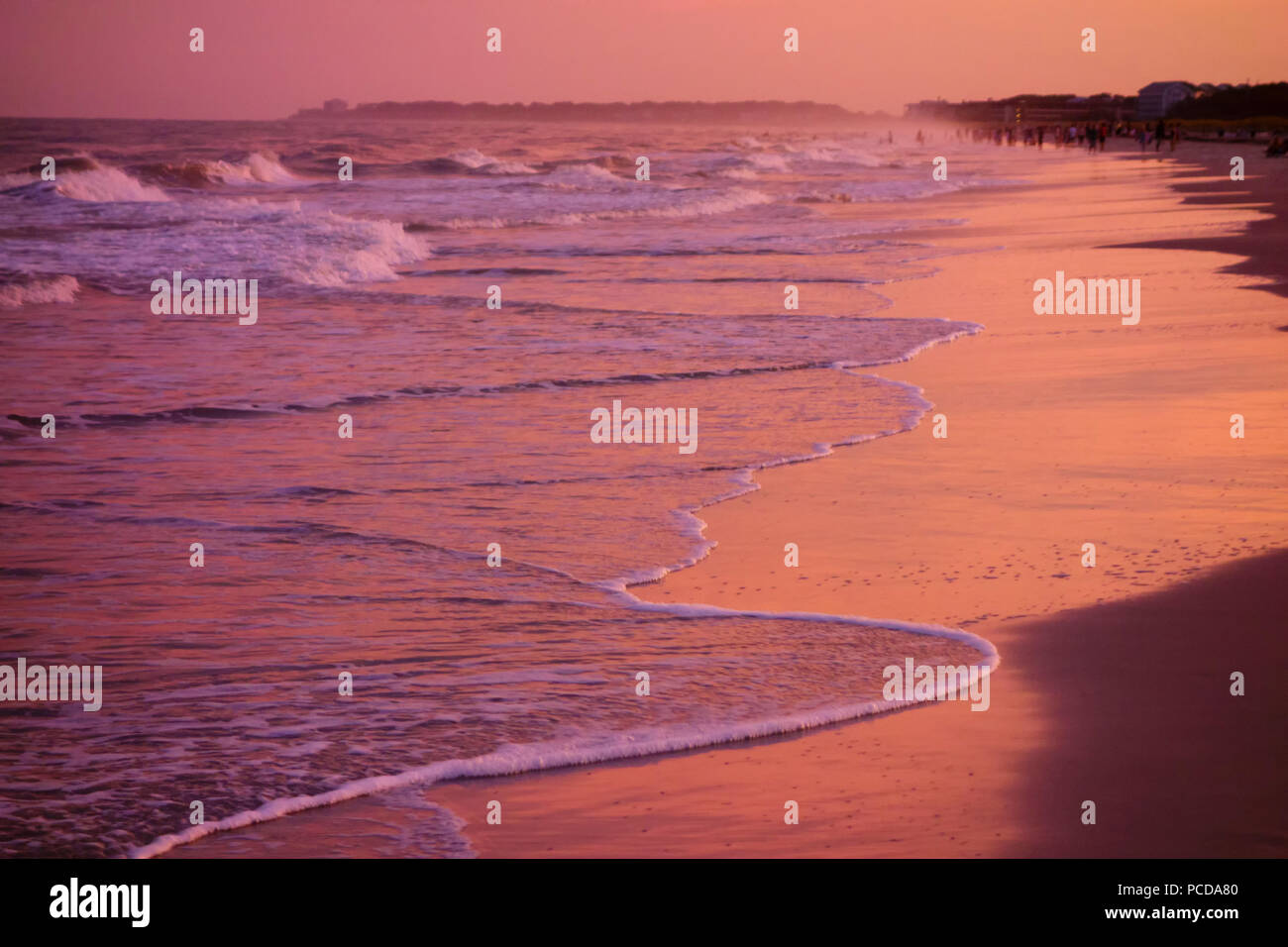 Dusk at Hilton Head South Carolina beach with waves on shore - Stock Image