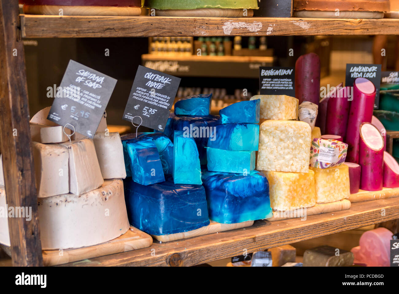 Shop counters display in Lush shop store, Italy - soaps, bubble bath, bath bombs etc lush cosmetics - Stock Image