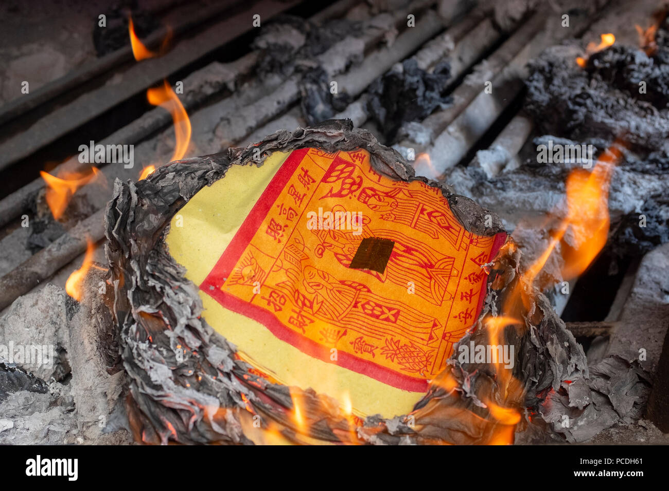 Joss paper burning in a chinese temple - Stock Image