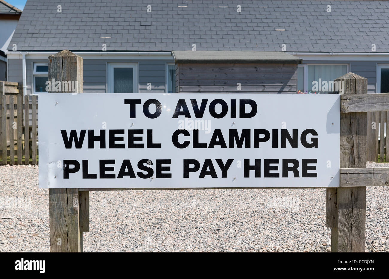 wheel clamping warning sign on private property. - Stock Image