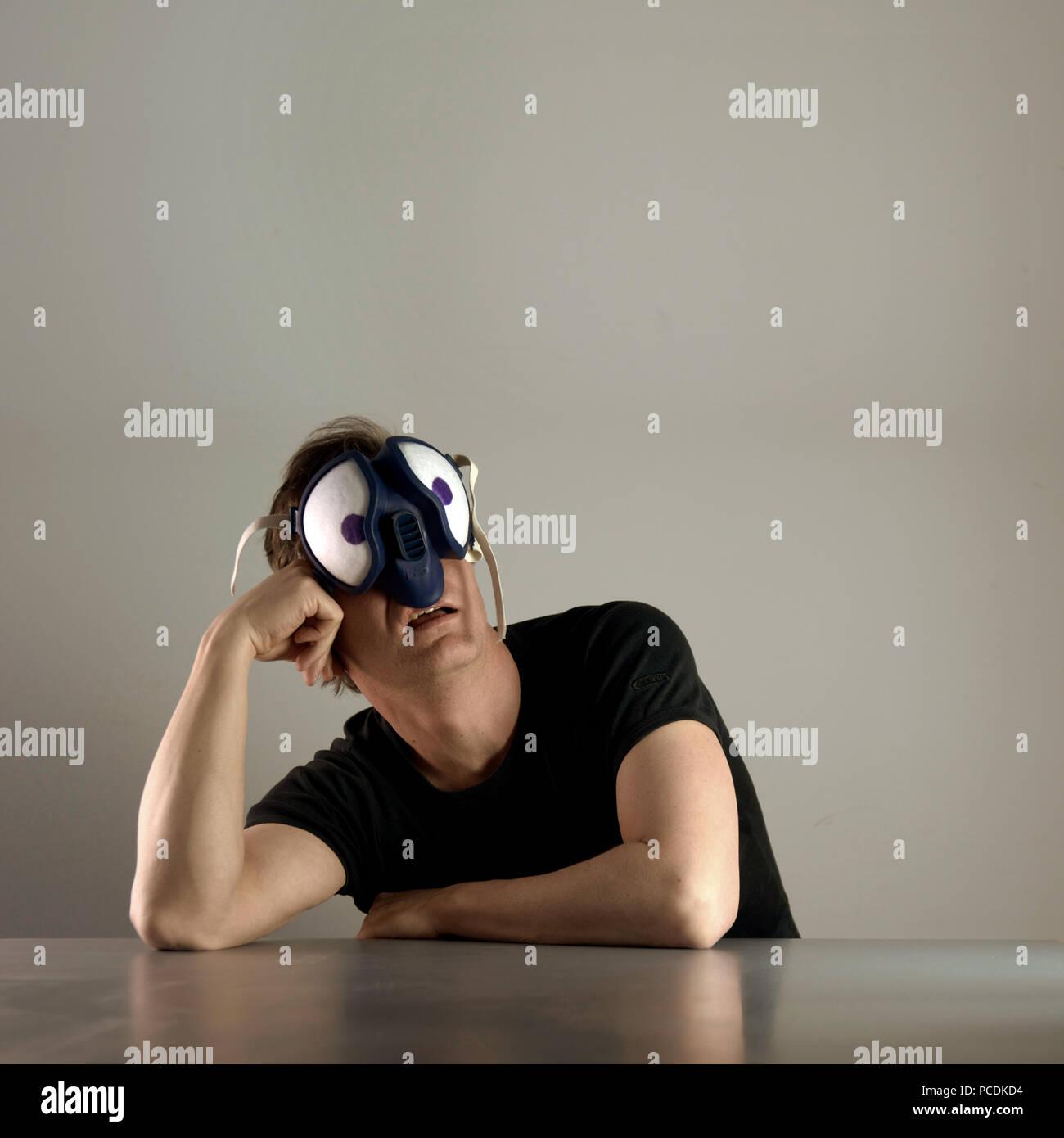 man,mask,compound eye - Stock Image