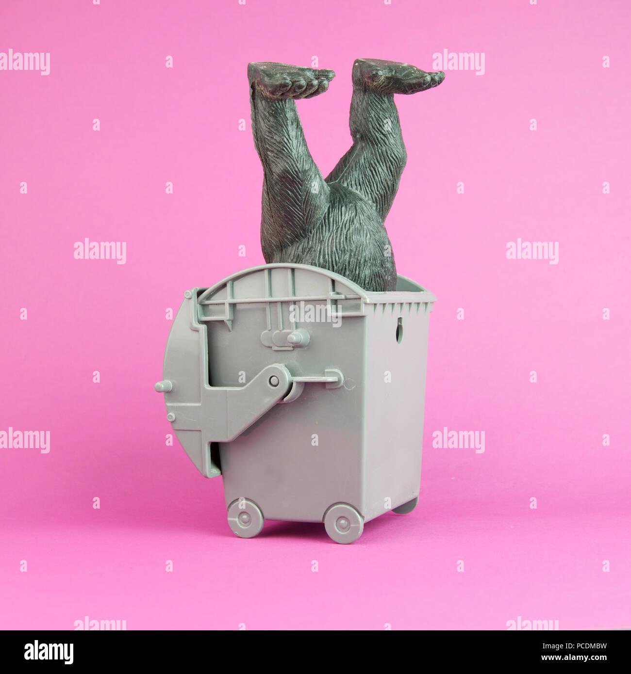 dustbin,garbage bin,headfirst,comic,toy figure - Stock Image