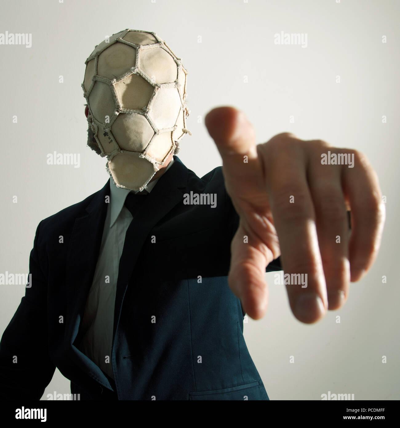 man,soccer,mask,clue - Stock Image