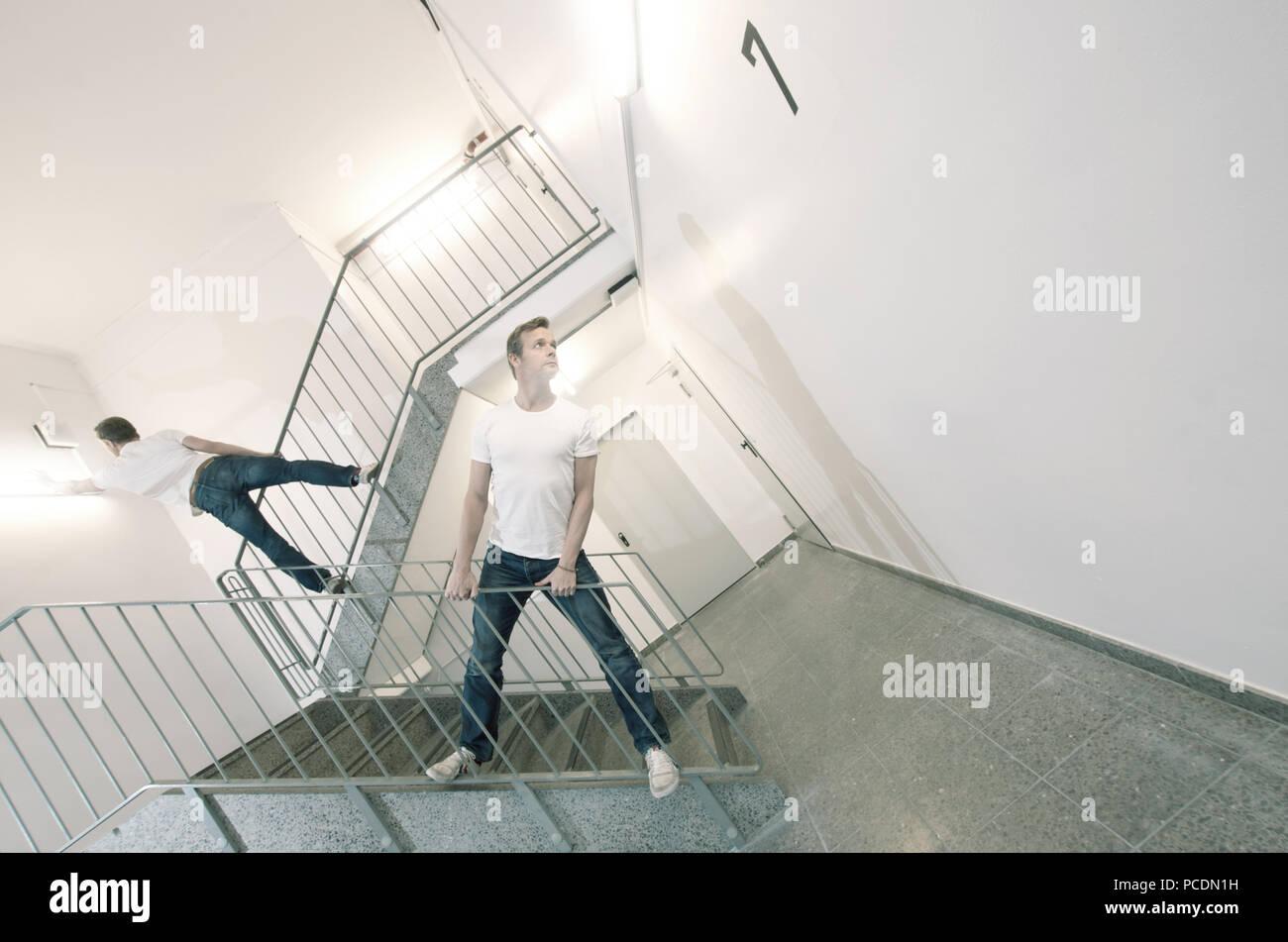 man,perspective,stairway,corridor - Stock Image