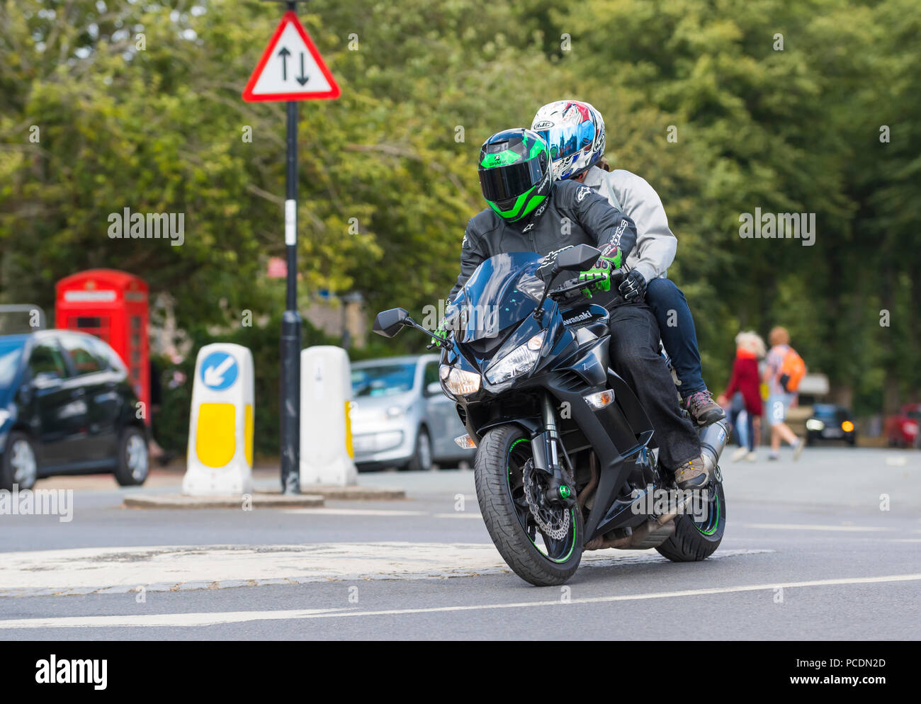 Person with pillion passenger riding on a Kawasaki Z1000SX motorbike in West Sussex, England, UK. - Stock Image