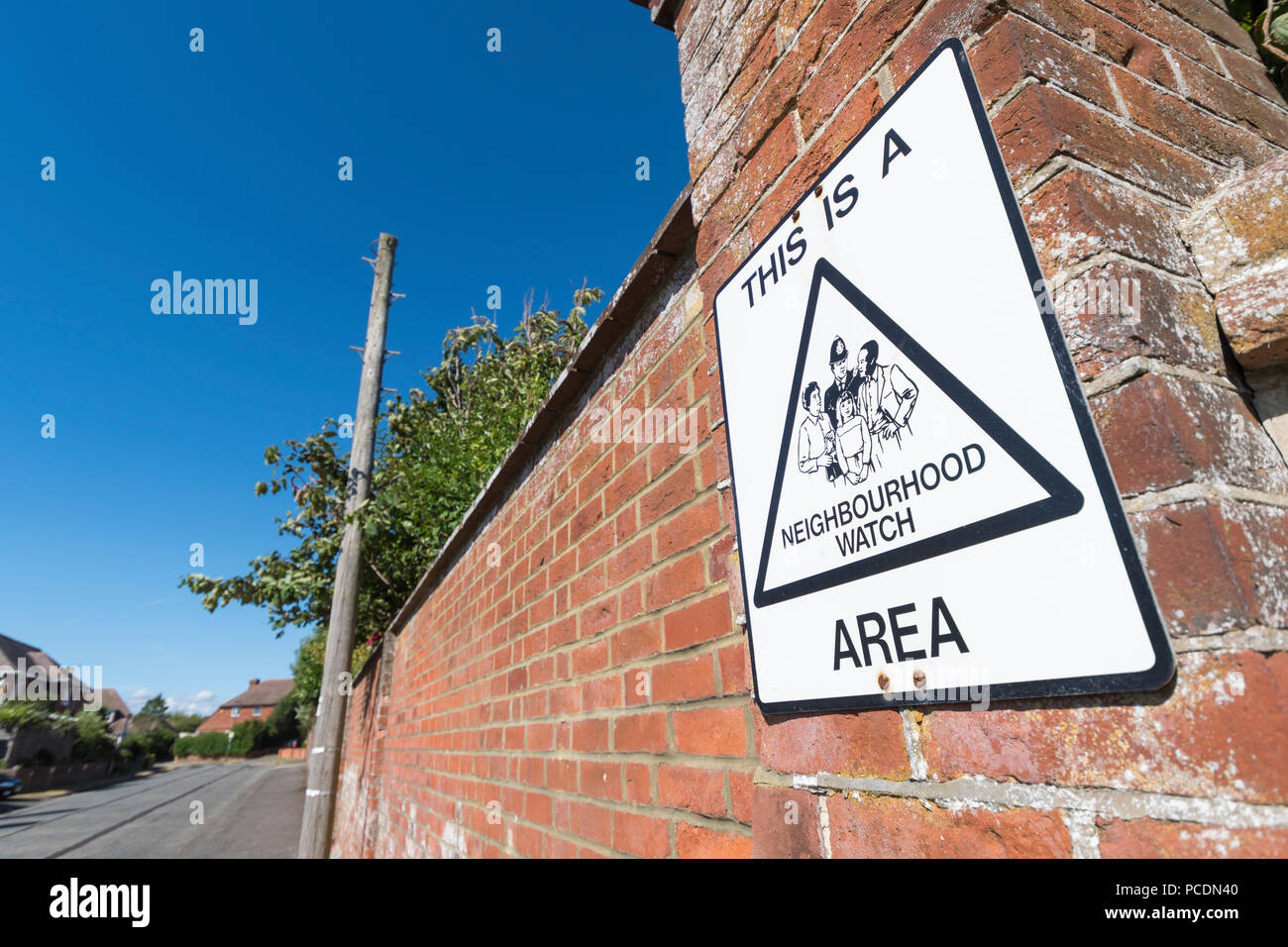 Neighbourhood watch sign on a wall at the end of a road in Littlehampton, West Sussex, England, UK. - Stock Image