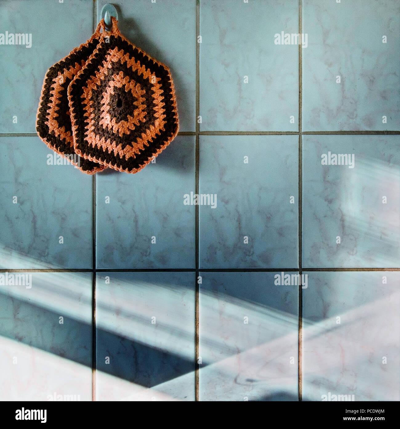 household,kitchen,tiles,oven mitt - Stock Image