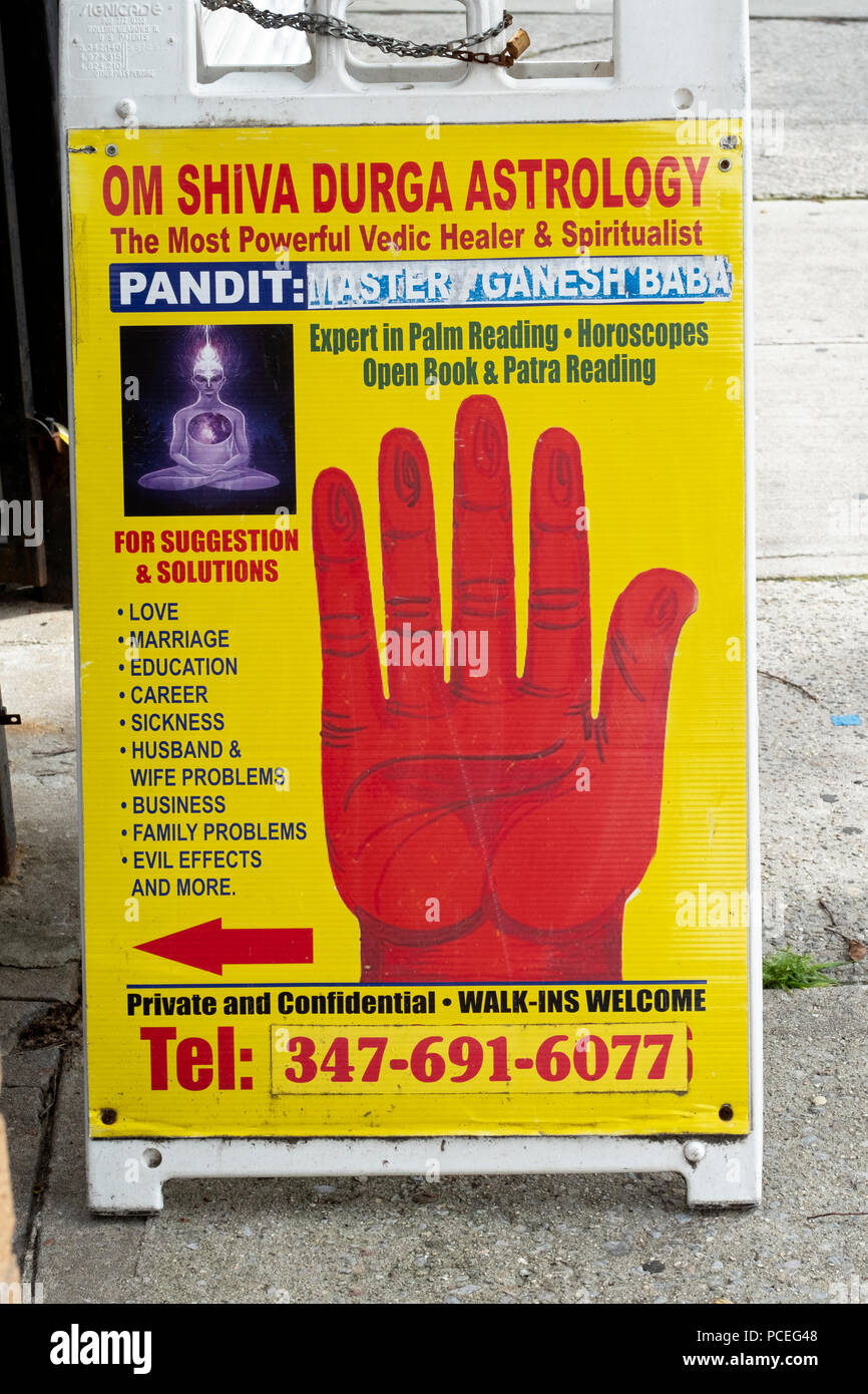 An astrologer pandith's sign offering to solve a range of