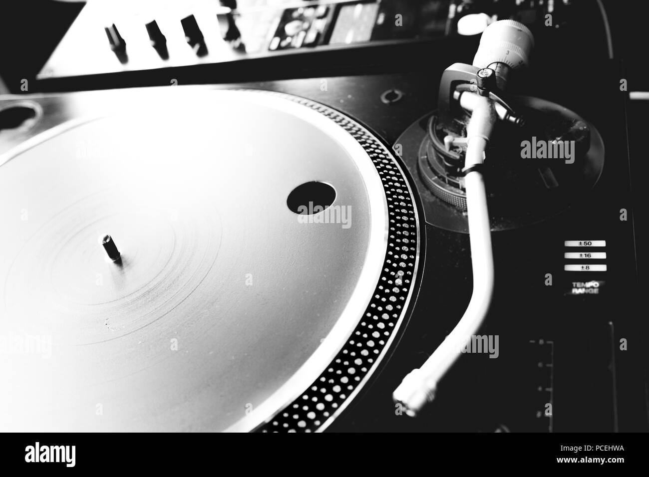 Black & white photo of a dj's turntable - Stock Image