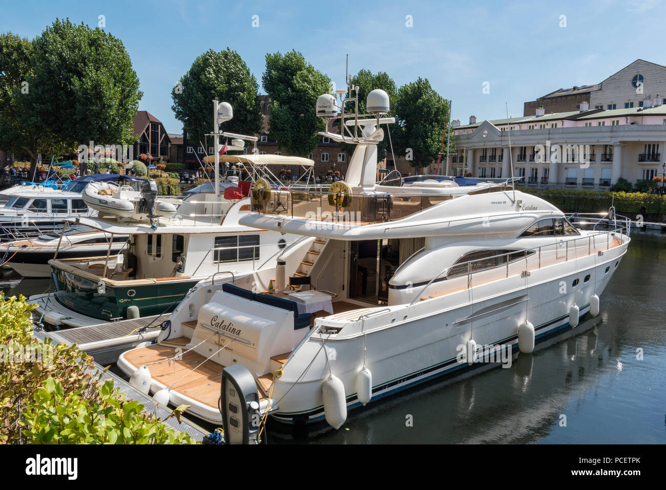 luxury motorboats and cruisers in st katherine docks in central london. - Stock Image