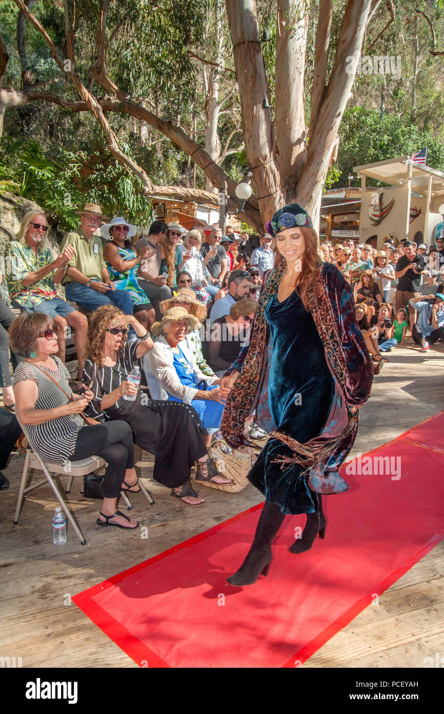 Audience Members Watch An Outdoor Fashion Show Of Local Designers In Laguna  Beach, CA. (Photo By Spencer Grant)