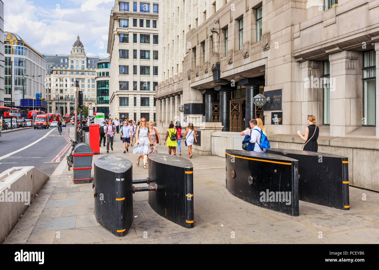 Counter-terrorism measures in the City of London: anti-vehicle bollards and barriers by Adelaide House on London Bridge in the financial district - Stock Image