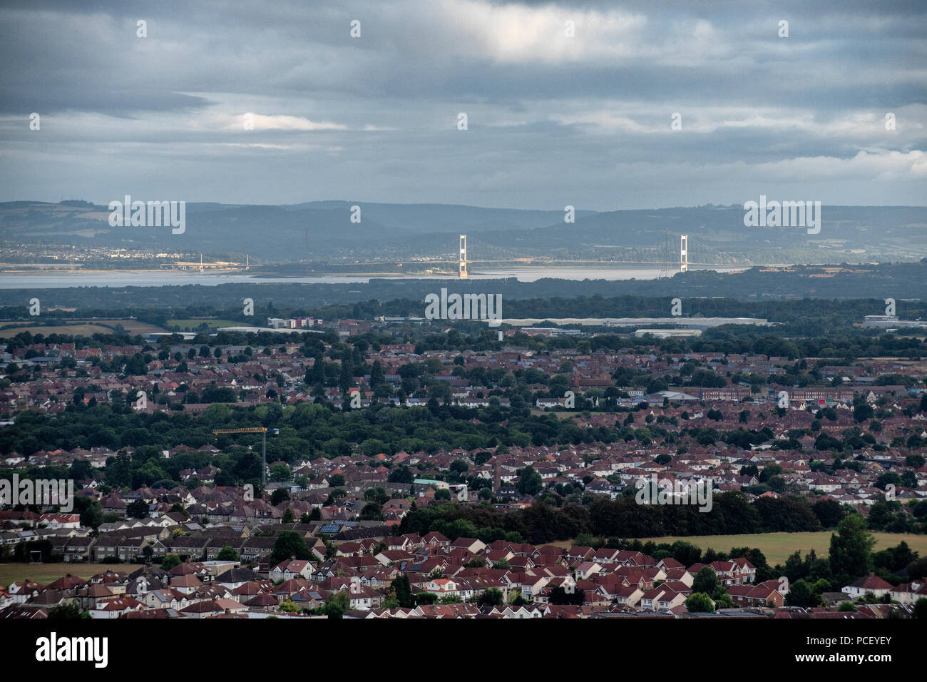 A view of the Severn Bridge from above the city of Bristol in the United Kingdom. - Stock Image