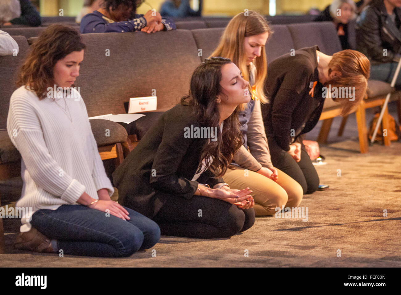 A prayer vigil at a Costa Mesa, CA, Christian college offers support to victims of human trafficking. - Stock Image