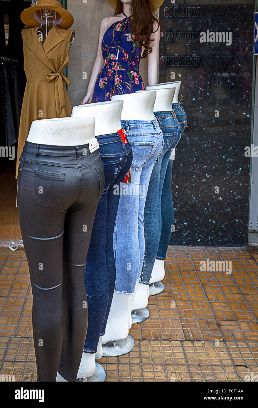 20a423f7642 Mannequins with tight jeans outside in front of retail store in Vietnam
