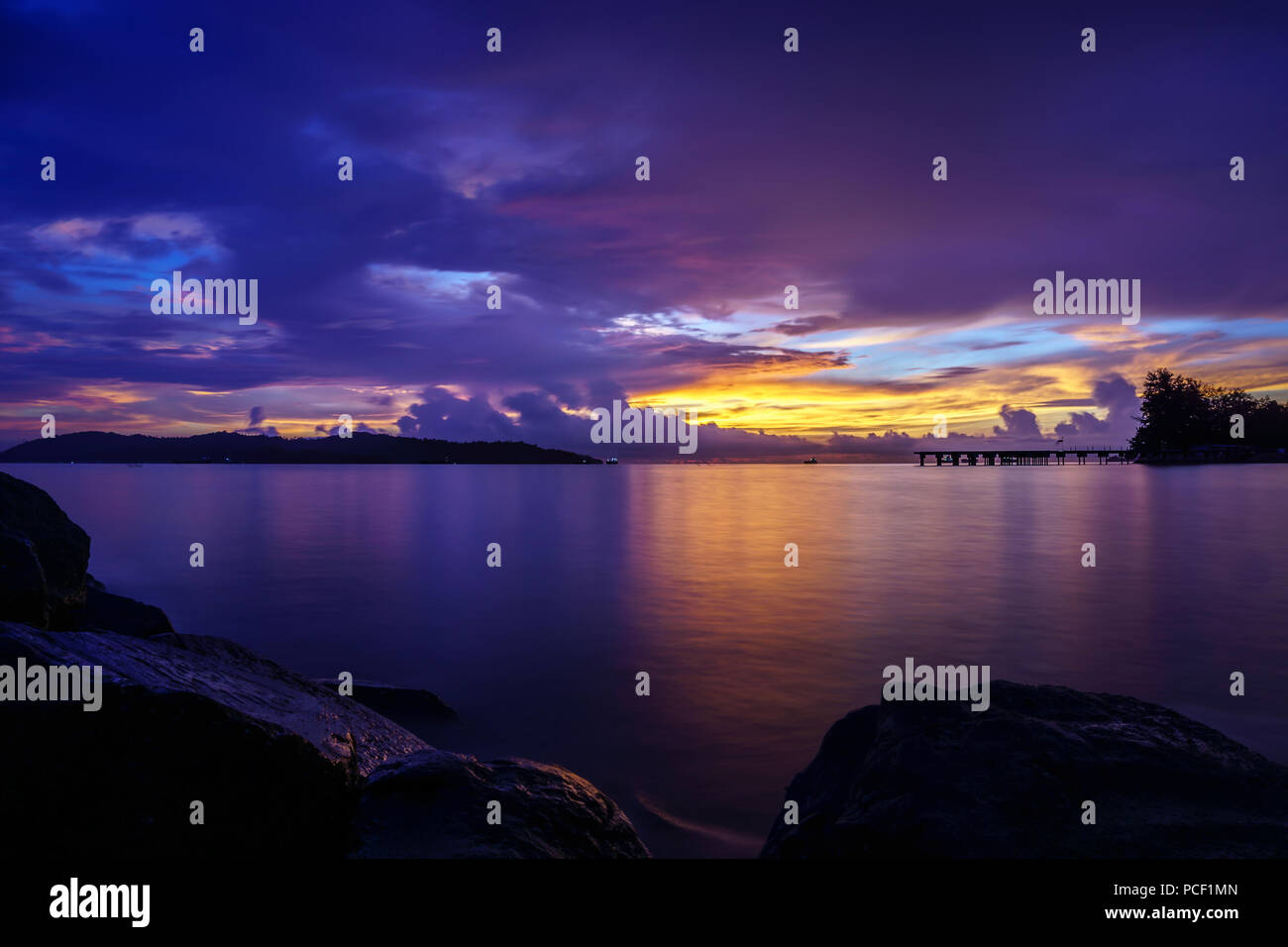 Beautiful sunset color in Kota Kinabalu Sabah. KK is known as the best place to see beautiful sunset in the world. - Stock Image