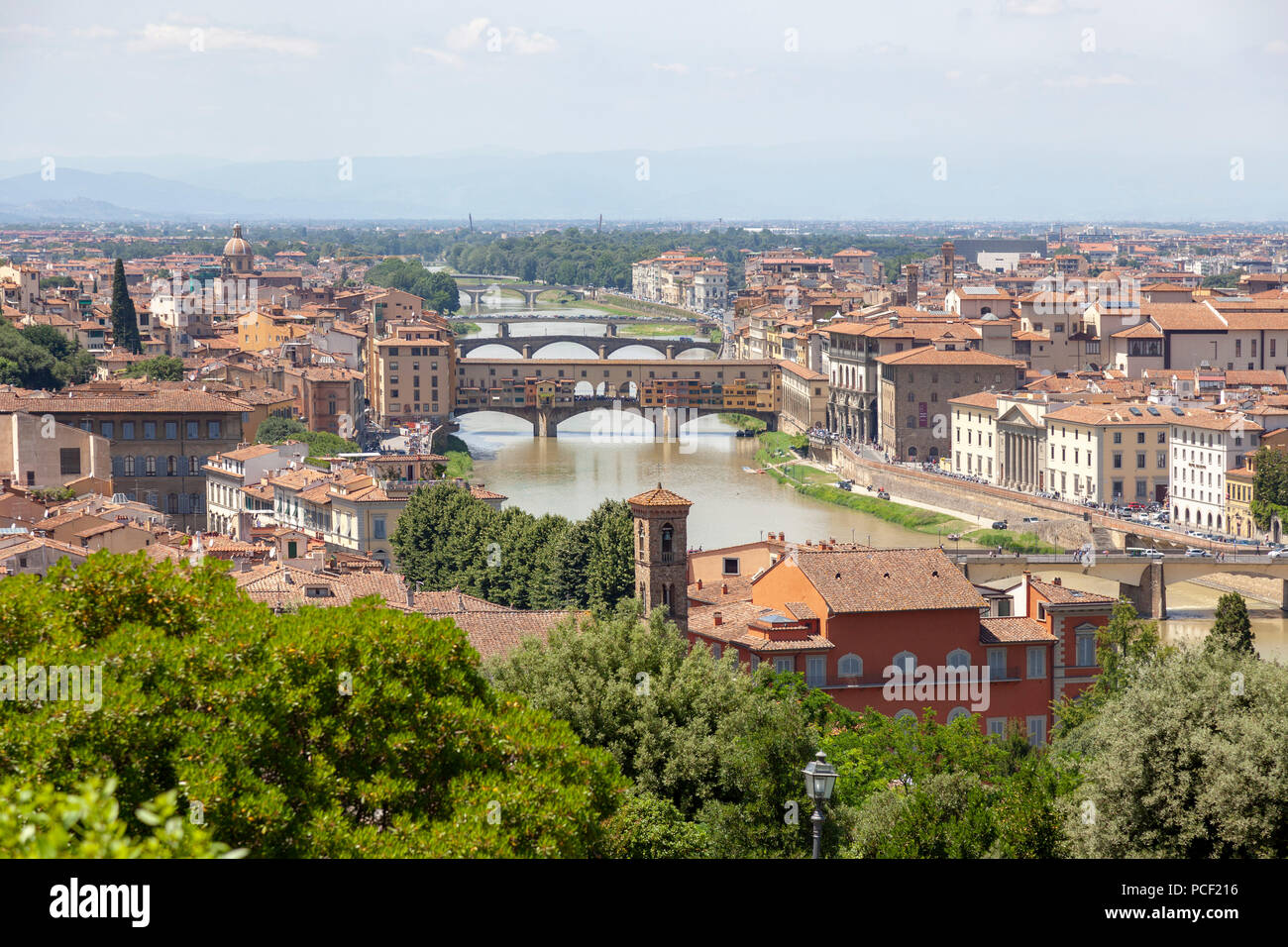 Seen from the Eastern vantage point of the Michelangelo Square: the bridges of Florence, mainly the iconic Ponte Vecchio (Tuscany - Italy). - Stock Image