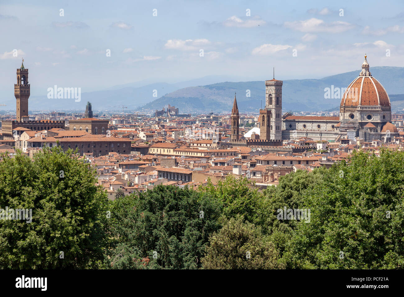 A view of Florence taken from the vantage point of  the MichelAngelo square and focusing from left to right on: the Palazzo Vecchio and the Duomo. - Stock Image