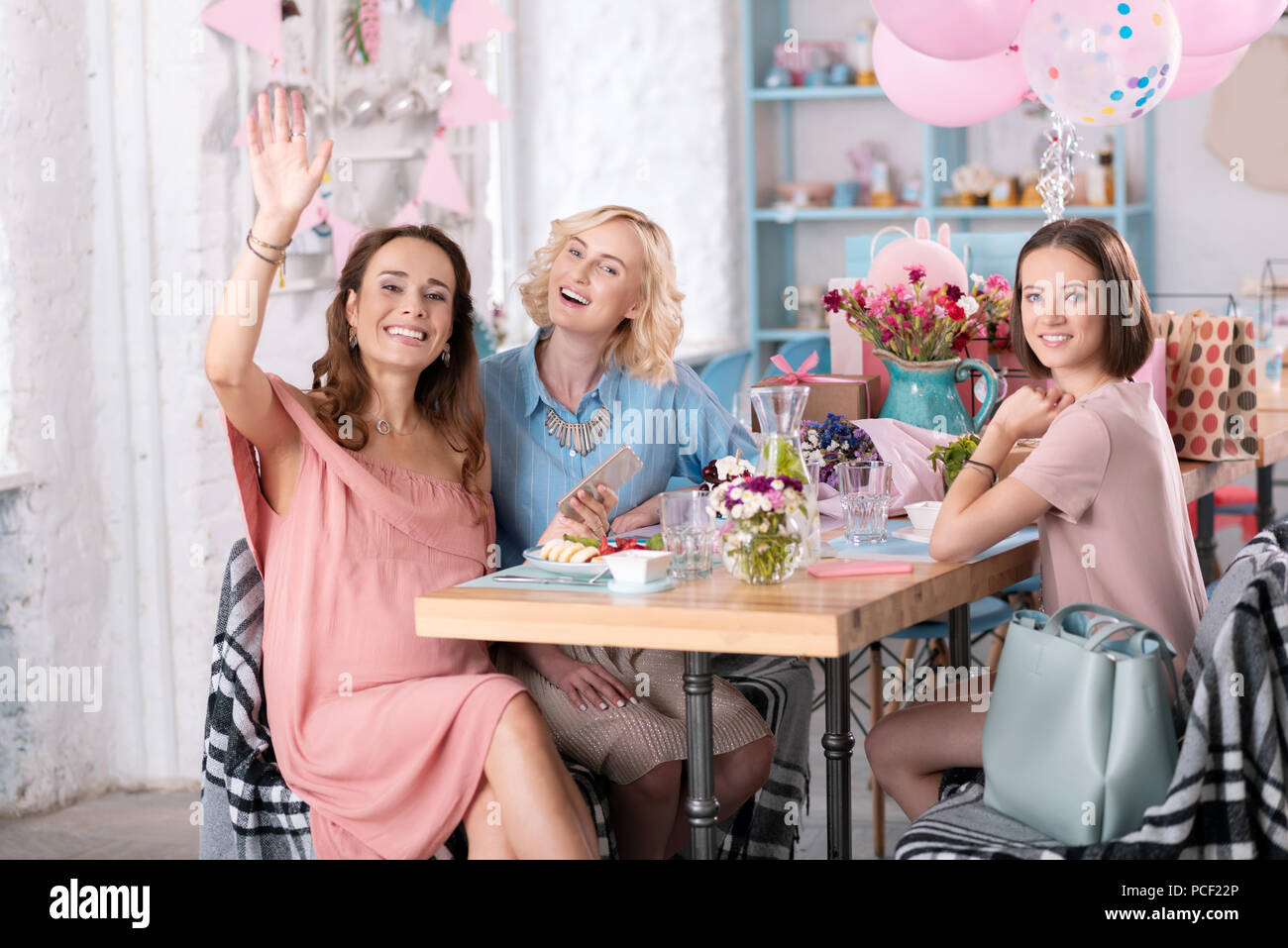 Three Women Celebrating Baby Shower In Nice Decorated Cafe Stock