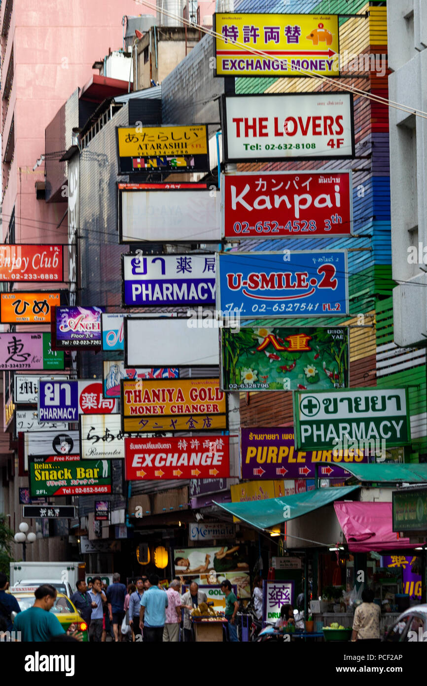 Bangkok, Thailand - April 30, 2018: Street signals advertising various commercial activities for tourist in Silom - Stock Image