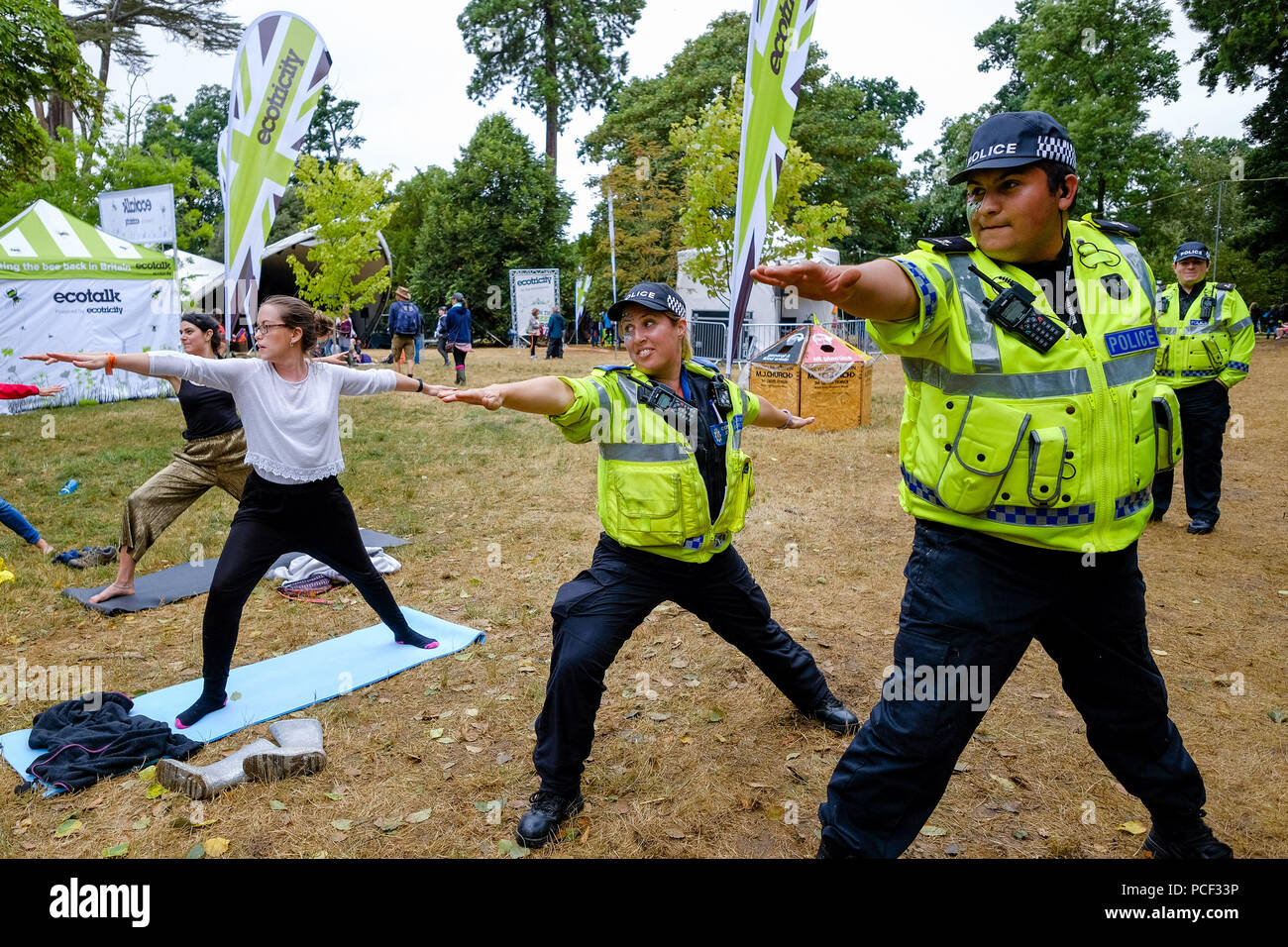 Police join a Yoga Class at WOMAD on Sunday 29 July 2018 held at Charlton Park, Wiltshire . Pictured: 2 Police officers of the Wiltshire Police Force joined in a free Yoga Class taking place in the World of Wellbeing . Stock Photo