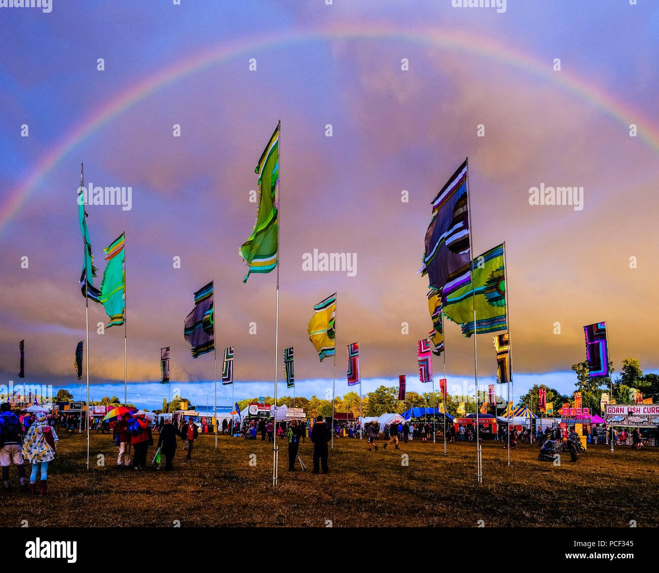 A Rainbow appears over WOMAD on Sunday 29 July 2018 held at Charlton Park, Wiltshire . Pictured: Following a day of rain and sun, a full rainbow appears over the festival at the close of the day. - Stock Image