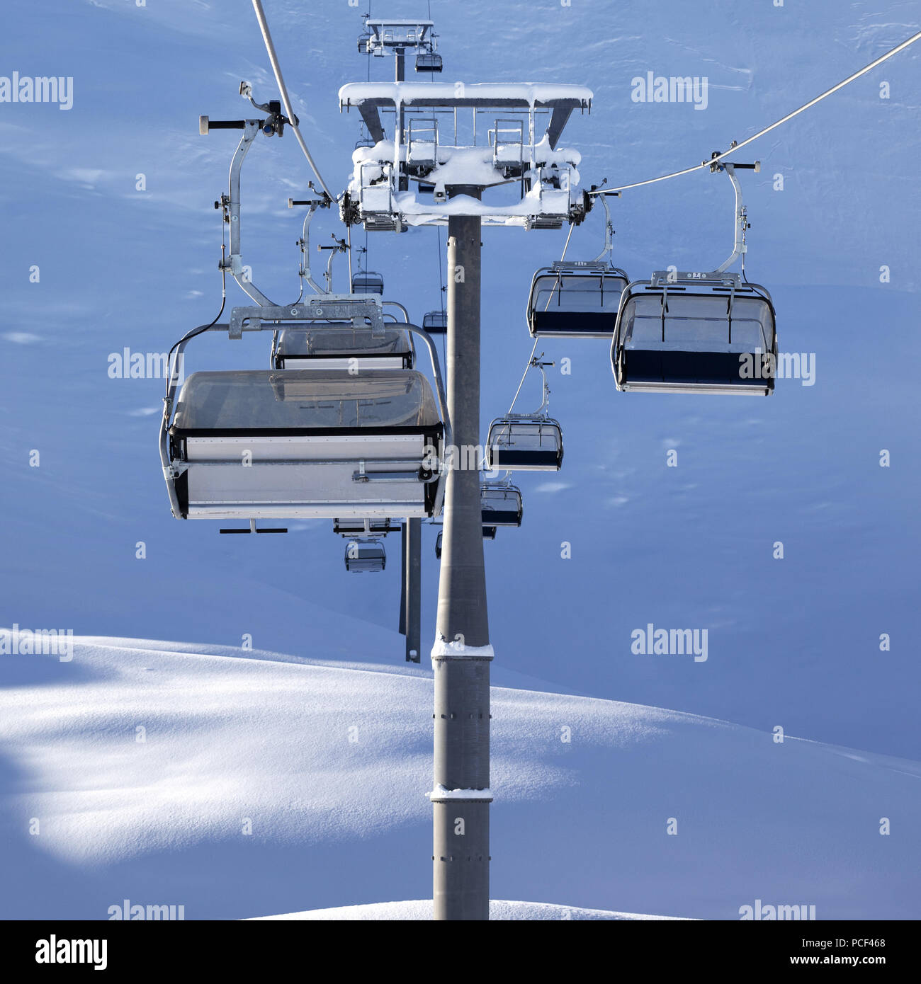 Chair-lift at early morning after snowfall  Greater Caucasus