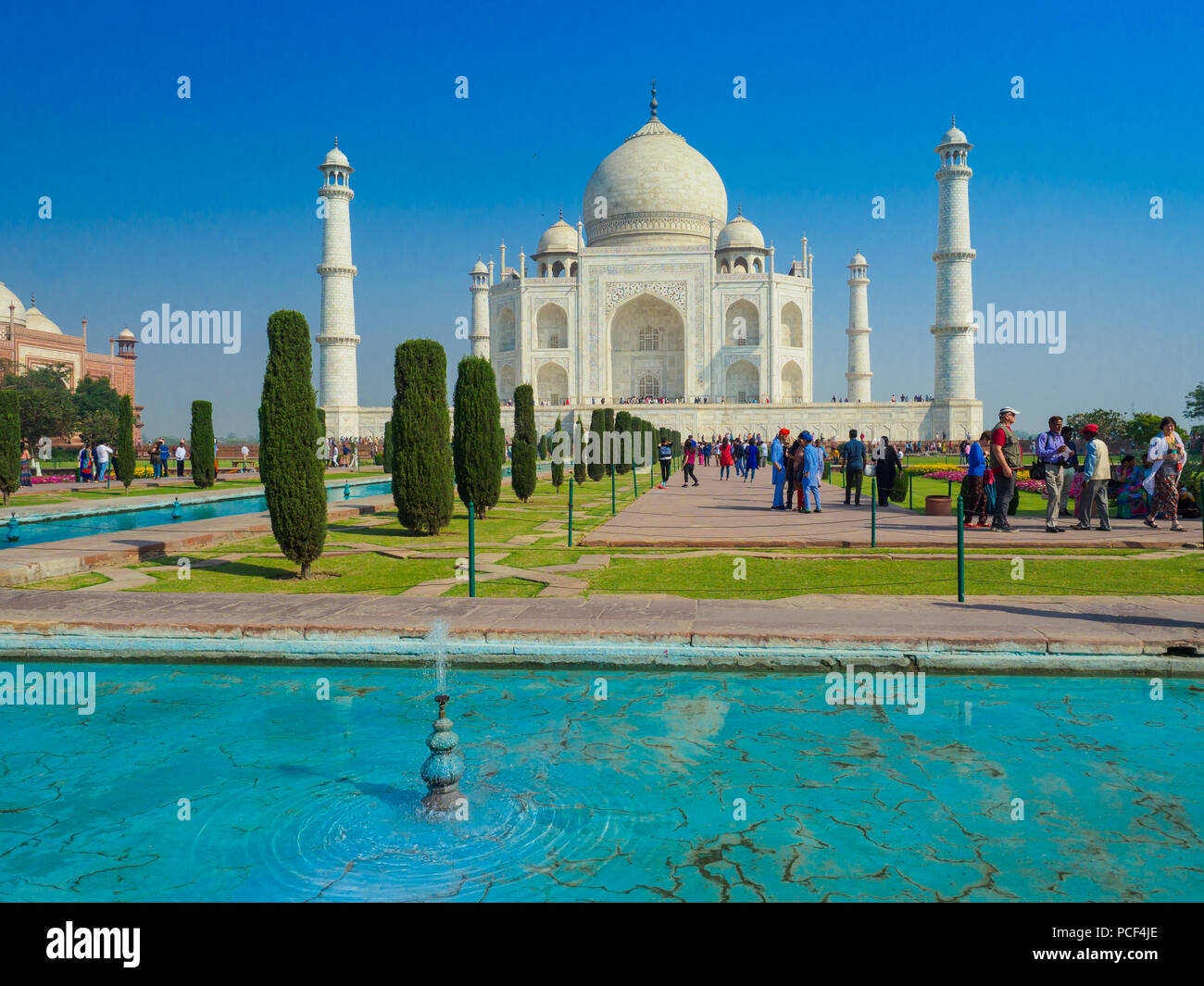 Tourists visiting the Taj Mahal, the ivory-white marble mausoleum in the city of Agra, Uttar Pradesh, India. - Stock Image