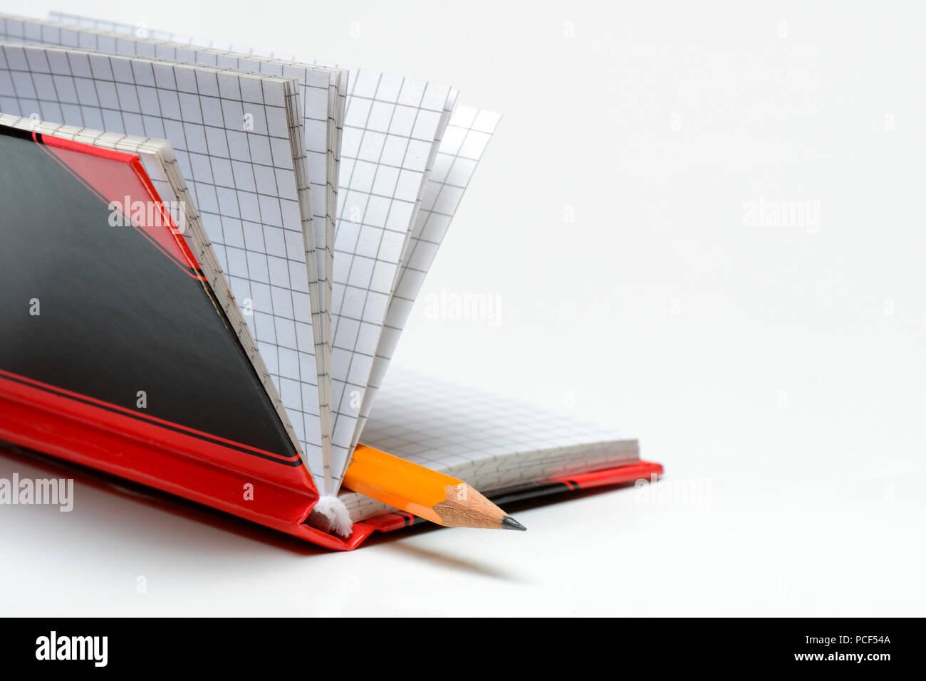 Bleistift in Notizbuch Stock Photo